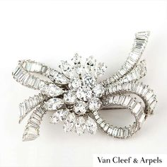 An exceptional Van Cleef & Arpels diamond brooch The central cluster of seven round brilliant cut diamonds are encircled by a half outer curve of marquise diamonds. The central round brilliant cut diamond weighs whilst the surrounding Bow Jewelry, Jewellery Uk, Pandora Jewelry, Diamond Jewelry, Jewelry Rings, Silver Jewelry, Fashion Jewelry, Van Cleef Arpels, Van Cleef And Arpels Jewelry