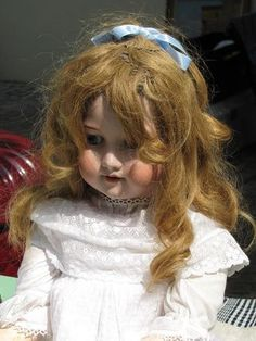 Beautiful old doll reminds me what my younger sister looked like as a little girl