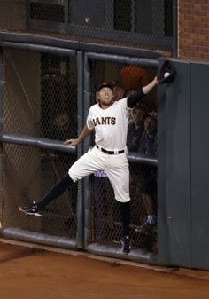 Giants Hunter Pence jumps for a Jayson Werth fly ball in the sixth inning  during Game 4 of the NLDS at AT&T Park on Tuesday, Oct. 7, 2014 in San Francisco, Calif.