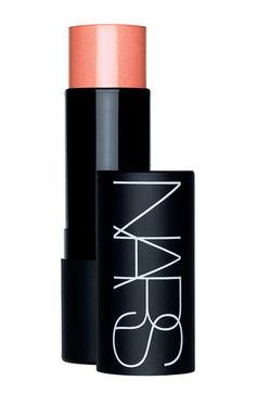 NARS 'The Multiple' Stick  Color: Orgasm  My all time favorite blush.    A multi-purpose stick for eyes, cheeks, lips and body. Its unique, lightweight, cream-to-powder formula blends effortlessly to provide sheer allover color, shimmering accents, contours and dynamic highlights for all skin tones.