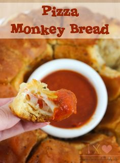 Pizza Monkey Bread is a savory twist on traditional sweet monkey bread. Each seasoned bread ball is stuffed with mozzarella cheese and pepperoni slices, and served with pizza sauce for dipping. Pizza lovers will enjoy Pizza Monkey Bread as a delcious appetizer, side dish or easy dinner. - Pizza Monkey Bread Recipe on Sugar, Spice and Family Life