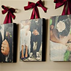 Mod Podge pictures to wood and hang with cute ribbon.