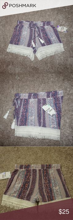 """HARMONY + HAVOC BOHO PRINT SOFT SHORTS PULL ON Harmony + Havoc pull on style shorts with pink, purple,  blue, and white print. White crochet trim with fringe and white tassels on drawstrings.  Size Small  Waist 14"""" across laying flat  Rise 10"""" Inseam 4.5"""" including fringe New with tags Harmony + Havoc Shorts"""