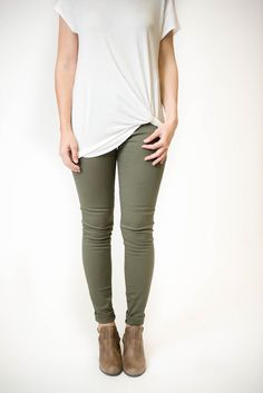 Slipping to the Olive Low Rise Skinny Jeans is something that comes naturally! Stretchy denim shapes around your curves and come together with a classic zipper and button closure that hits at the hips
