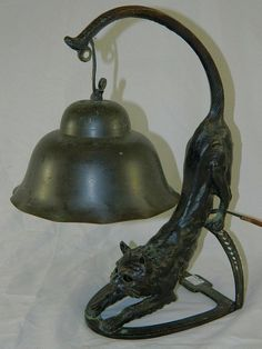 Vintage bronze cat lamp–--- mine has a glass orange and blue shade