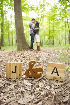 Scrabble letter tiles! Forest Preserve Engagement pictures. Green, trees, brown leaves. Nature inspired! Love her brown boots! Photos by Chicago Engagement Wedding Phootgrapher: Nakai Photography http://www.nakaiphotography.com