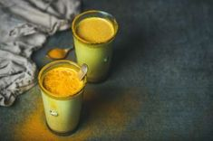 Golden milk with turmeric powder, natural cold fighting healthy drink by sonyakamoz on PhotoDune. Golden milk with turmeric powder in glasses over dark background. Health and energy boosting, flu remedy, natural col. Turmeric Tea Benefits, Turmeric Drink, Turmeric Smoothie, Turmeric Recipes, Ayurveda, Coffee Bad For You, Healthy Drinks, Healthy Recipes, Healthy Milk
