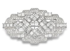 A diamond brooch  Of openwork geometric design, formed as a multi-tiered cluster of square-cut diamonds, to a brilliant and square-cut diamond surround, mounted in 18k white gold, the diamonds estimated to weigh approximately 18.70 carats in total, brooch length 6.8cm. Art Deco or Art Deco style.
