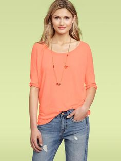 Just bought this shirt in turquoise and gray from the Gap.  Great to dress up or down!