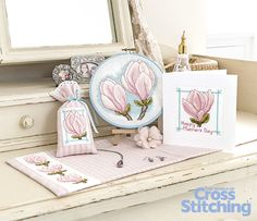 Magnolias to cross stitch for spring. Bursting with beauty, #crossstitch a stunning #magnolia flower set, created to decorate a bedroom - so pretty to make as #Mother'sDay gifts. Enjoy the patterns only in the new issue 227 of The World of Cross Stitching magazine