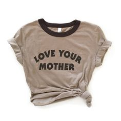 TheBee and The Fox Love Your Mother tee is professionally screen printed on a chocolate/tan ringer tee. This throwback tee features a jersey poly-cotton blend