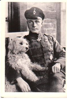 WW I Photo German Pilot Ace W. von Bulow Wearing Hussar Uniform With Skull And Crossbones Badge On His Hat. Posing In Chair With His Dog (Hilmer) On His Lap.