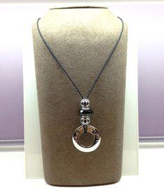 Lariat design using a black cord, Pandora watch bezel, one facinating black Murano glass bead, and two life's rhythm beads. #Pandora #lariat #necklace