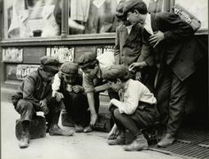 Newsboys and bootblacks playing craps, photographed by Lewis Hines in 1912.