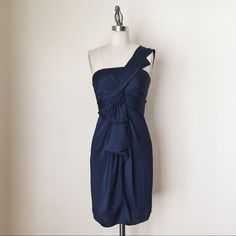 """BCBG   Navy One Shoulder Cocktail Dress FEATURES:  *One strap shoulder  *Waterfall & pleating detail on bodice  *Rear invisible zipper  *Falls at high thigh  *Fully lined  *100% polyester  MEASUREMENTS: Bust - 30"""" Waist - 25"""" Hips - 32"""" Length - 35 1/2""""  ✅ NWT ⛔️ NO SWAPS/TRADES/RESERVES BCBGMaxAzria Dresses One Shoulder"""