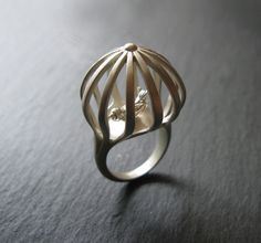 ring bird Silvia Barbagallo. I wouldn't wear it, but it's so poetic.