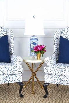 Society Social Wing chairs upholstered in a favorite fabric of mine - Brunschwig & Fils Les Touches with a blue and white Chinese porcelain lamp and a pop of pink peonies.