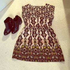 Printed Dress Such a cute dress with the brown and black pattern and the touches of green at the bottom! There is a zipper in the back that adds shape to the cinched in waist. This dress fits wonderful and is gently used. Has no visible wear and has a lot of life left! BeBop Dresses Mini