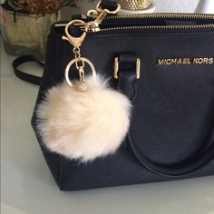 IT'S BACK! CREAM POM POM KEYCHAIN!! Brand new!! Never used, faux rabbit fur keychain!! Comes with a Pearl attachment, along with a gold chain and gold clamp!! Fur is very soft. Super cute to hang on your purse or keys! Approx. hangs 4 inches and actual Pom Pom is 8cm. All sold Keychains will be bubble wrapped so you have to play with the fur to get its circular shape, or allow a day for the fur to settle itself! No trades. Purse is not for sale. This keychain has no brand. Accessories Key…