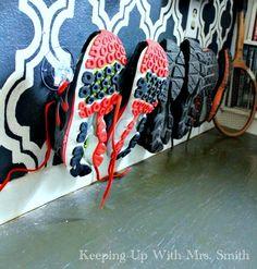 She nails clear suction cups to the bottom of her wall. The reason why? This entryway storage is genius!
