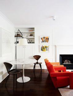 The simplicity of this space lets those amazing red-orange chairs take center stage.