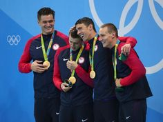 "Michael Phelps told American youngsters Caeleb Dressel and Ryan Held to ""let the tears out"" after they broke down with emotion following the United States' dramatic victory in the men's 4x100-meter freestyle relay on Sunday night."