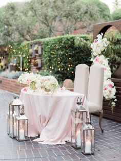 Blush pink floral accented bride and groom table: http://www.stylemepretty.com/2015/11/17/elegant-santa-monica-tiato-wedding/ | Photography: Honey Honey - http://hoooney.com/