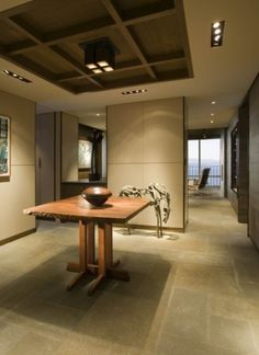 flagstone flooring, beautiful Thomas Moser/arts table with bronzed vase and sculpture