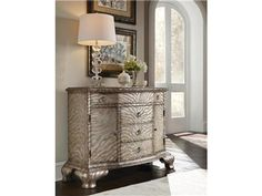 The metallic finishing on this Pulaski Furniture Accent Chest makes any neutral bedroom sparkle! Available from West Coast Living.