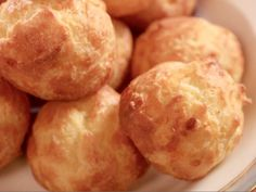 Get Cheese Puffs (Gougeres) Recipe from Food Network - Baked in Vermont - try adding olives Yummy Appetizers, Appetizer Recipes, Christmas Appetizers, Party Appetizers, Christmas Recipes, Christmas Eve, Pastry Recipes, Cooking Recipes, Cooking Stuff