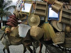 Baskets on sale by a roving salesman on a carabao in the Philippines
