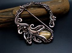 Items similar to Embrace of the Sun - Penannular Brooch, Shawl Pin from Copper adorned with Fire Labradorite on Etsy Hair Jewelry, Metal Jewelry, Custom Jewelry, Jewelry Art, Jewelry Crafts, Jewelry Design, Unique Jewelry, Jewlery, Brooches Handmade