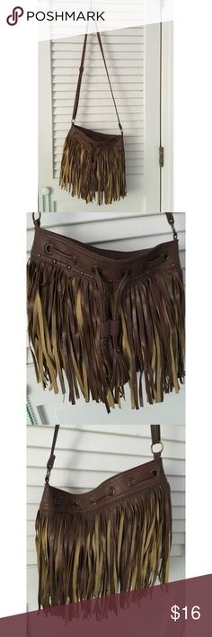 Delia's Brown Fringe Purse Brand: Delia's Material: Leather Colors: Brown/Tan Print: N/A Size: Medium Zippers: No Pockets: 1 zipper pocket on the inside Additions: Adjustable straps, can be used as a crossbody or a satchel Worn: Multiple - excellent condition Delia's Bags Crossbody Bags