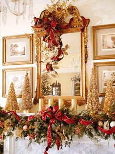Red and gold holiday mantle decor   Photo:http://www.bhg.com/christmas/garlands/holiday-garland-ideas/#page=18