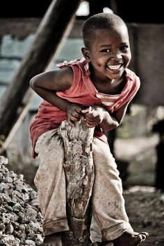 Little boy playing in Mombasa. Happy kid!