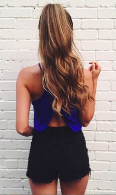 Blonde- Loose curls with a large barrel curling iron, then pulled into a smooth tight high ponytail