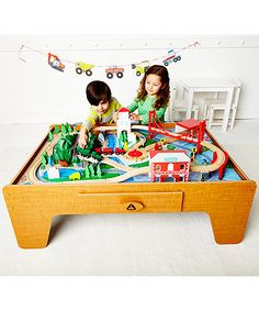 ELC Wooden Train Table. There's lots to do on the Wooden Train Table: drive the trains out of the shed, over the bridges and all around the table for endless railway adventures.