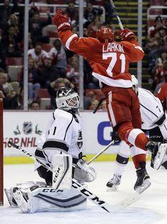 Detroit Red Wings center Dylan Larkin leaps after scoring
