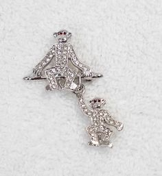 Extremely rare! The silver monkey duo pin! On auction now, a rare pin from Joan Rivers' estate. From her personal jewelry box; one she actually wore. Please see the others too--we have 40 pins from her estate, on sale now