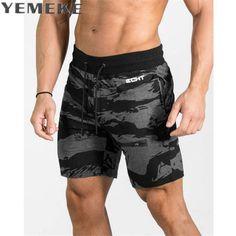 cbbbec17899e YEMEKE 2017 new shorts men fashion brand orignal design camouflage shorts  brand hip hop street wear size M XXL-in Shorts from Men s Clothing    Accessories ...