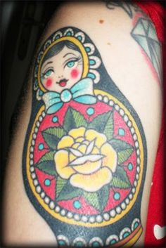 Cute matryoshka tattoo; trying to decide how to design my second doll so she doesn't clash with the first.