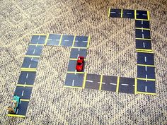 "black construction paper rectangles - roll dice and move your car along the laminated path. (add motion squares ""3 jumping jacks!"" ""touch your toes"" ""4 cherry pickers"""