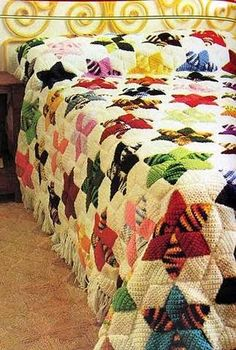 so lovely. mix of crochet and vintage handmade quilt-esque