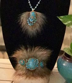 A personal favorite from my Etsy shop https://www.etsy.com/listing/546659324/turquoise-and-faux-fox-fur-bracelet