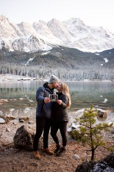 Travel baby announcement on Eibsee lake. Located in Bavarian Alps, foot of Germany's highest peak Zugspitze. Pregnancy Announcement Pictures, Cute Baby Announcements, Couple Pregnancy Pictures, Maternity Pictures, Baby Flu, Outdoor Baby, Baby Kind, Instagram, Nursery