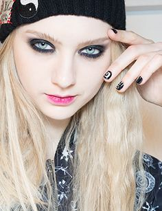 The look: ManicuristHolly Falcone detailed jet-black nails with tiny white doodles.