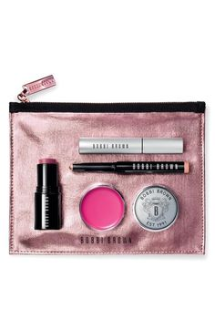Off-duty makeup essentials. All wrapped up in a pretty pink bag.