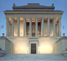 """House of the Temple at dusk, Washington D.C. Above the beautiful bronze door entrance reads, """"Freemasonry Builds its Temples in the Hearts of Men and among Nations""""."""