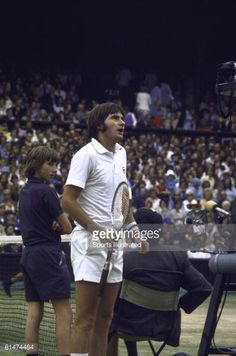 Wimbledon, Jimmy Connors speaking with umpire during match vs Arthur Ashe at All England Club, London, GBR 7/7/1975
