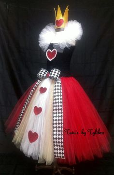 ******NOTICE - 4 week turnaround time on this item******  This adorable Queen of Hearts inspired tutu dress is great for an Alice in Wonderland theme party, halloween costume or just for fun! This tutu dress is made with a black stretch crochet tube top then I add layers of fluffy red, white and gold tulle with glitter tulle mixed throughout - just to add some sparkle. A white tulle collar (attached with Velcro so it can be adjusted or removed) and a red glitter heart with pearl trim…